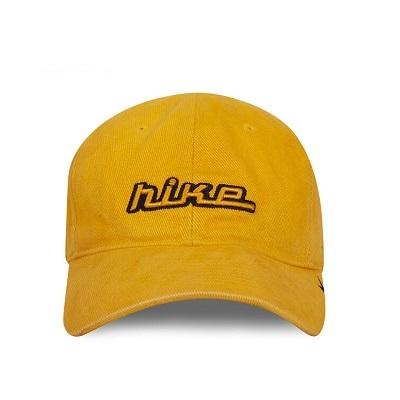 Đồng phục nón kết màu vàng thêu chữ Nike